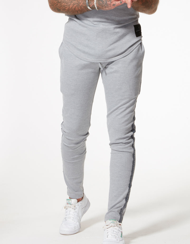 TAPED JERSEY TRACK PANT MARL GREY - H E R M A N O