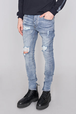 Light Blue Ripped Skinny Jeans - H E R M A N O