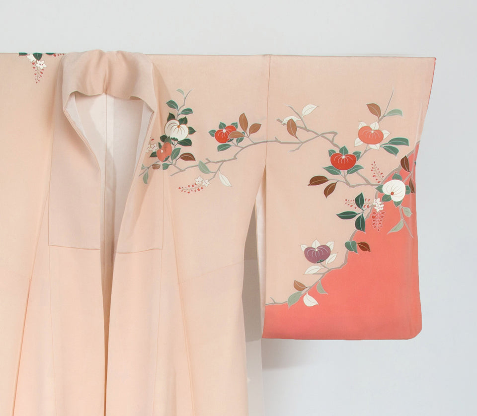 Design Distupers peach vintage kimono featuring a floral design