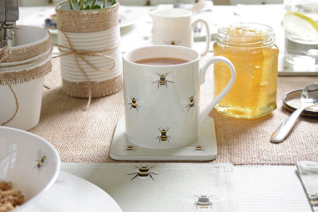 Bee design fine bone china cup of tea on breakfast table
