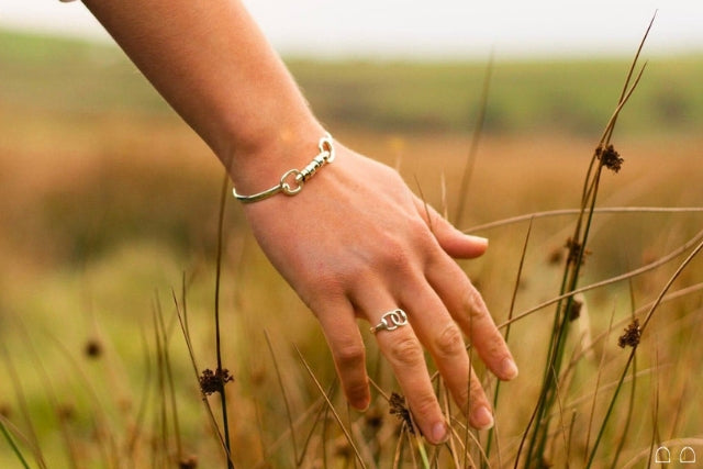 Womans hand showing equestrian inspired jewellery from Hiho Silver Jewellery