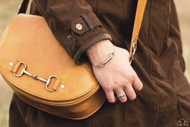 womans equestrian inspired leather handbag in tan leather