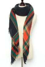 Load image into Gallery viewer, Orange, Green, and Black Plaid Blanket Scarf by Just Cozy.