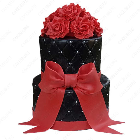Elegant Black and Red Ribbon Cake