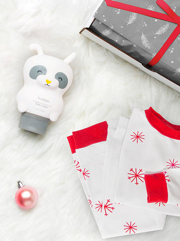 Snowflakes pajamas and body cream in panda bottle with wrapped gift