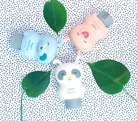 Bubbsi bottles with leaves and polka dot background