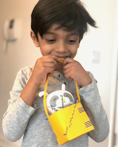 Boy holding adorable easter basket with natural skincare