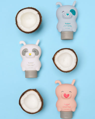 bubbsi bottles (dog shaped, pig shaped, and panda shaped bottles ) in parallel lines next to coconuts