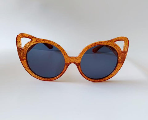 amber brown sunglasses with winged eye frame