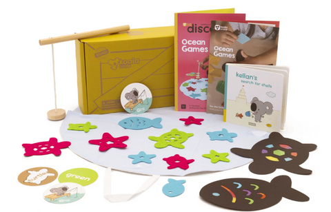 child's activity set  with cardboard cut out of fish and stars laid out on ground