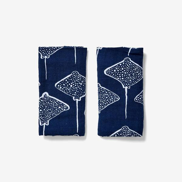 Patterned with a unique stingray graphic and composed of durable organic cotton, these burp cloths