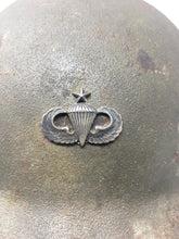 Korean War era helmet shell with Master Jump Wings