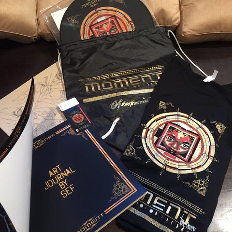 $100 MOMENT COLLECTIBLE SWAG BAG! MOMENT LIMITED PICTURE VINYL (SIGNED & NUMBERED/200), AUDIO/VIDEO DOWNLOAD CARD, HANDMADE ART JOURNAL, T-SHIRT, STICKERS...(Scroll Down for Audio Player)