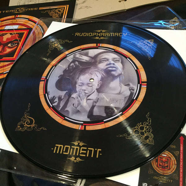 MOMENT DONATION ($100 PLEDGE) - COLLECTIBLE SWAG BAG!: MOMENT LIMITED PICTURE VINYL (SIGNED & NUMBERED/200), AUDIO/VIDEO DOWNLOAD CARD, HANDMADE ART JOURNAL, T-SHIRT, STICKERS...(Scroll Down for Audio Player)