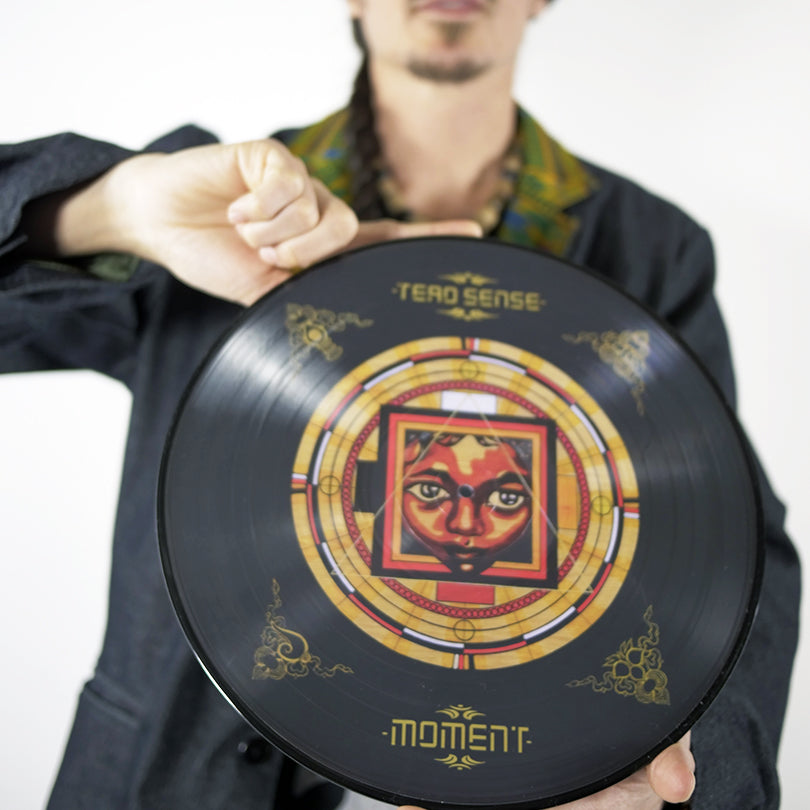 MOMENT LIMITED PICTURE VINYL (SIGNED / 200) & AUDIO / VISUAL DOWNLOAD CARD (Audio Player Below)