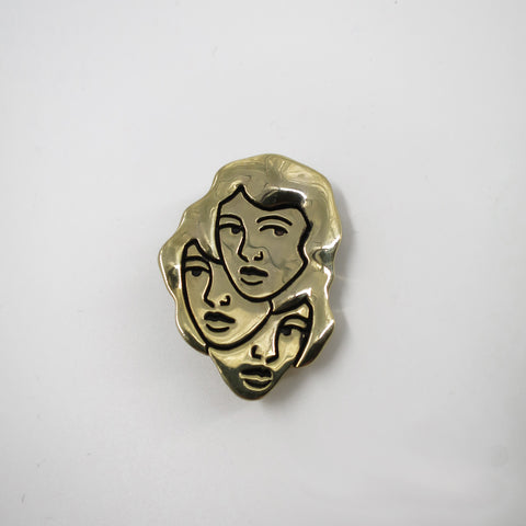 3 heads brooch