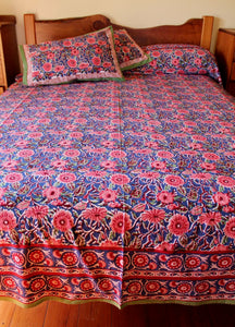 Hand block printed cotton bedsheet - pink blue flower multi