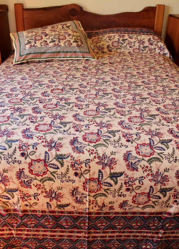 Hand block printed cotton bedsheet and pillow set - cream red blue multi