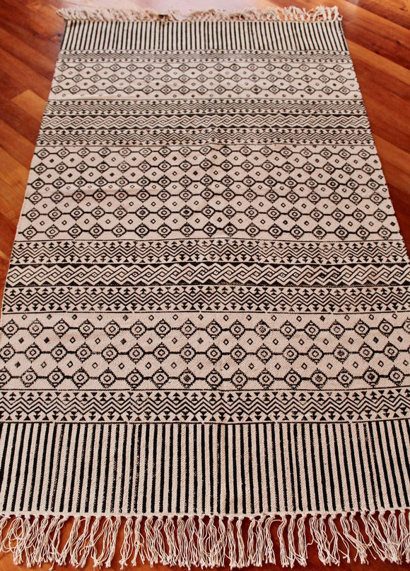 Woven cotton floor rug - cream with black