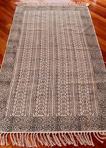 Woven cotton floor rug - cream with black zig zag