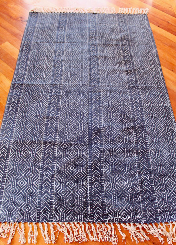 Woven cotton floor rug - dark blue with white