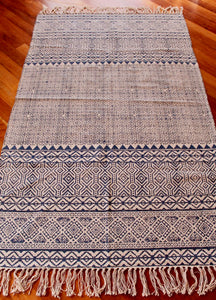 Woven cotton floor rug - cream with blue