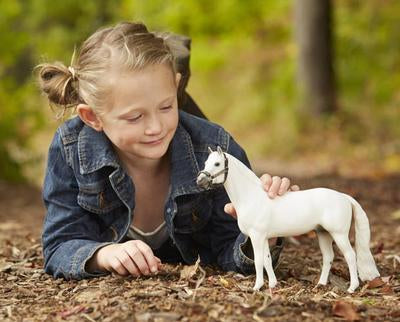 Little Girl with Snowman the Breyer horse.