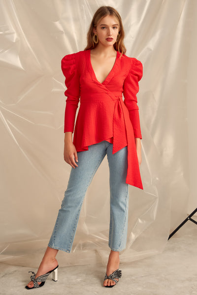 Advance cherry top. Cherry red wrap top in a textured fabric. Relaxed fit and volume on upper sleeve. Found at Blush and Lace Oakville boutique. Top, puff sleeve, side tie, red, long, blush and lace, Oakville, boutique