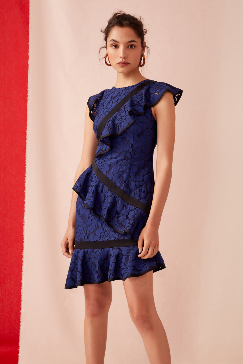 Keepsake The Label Encore lace dress cobalt. Is a soft fit and flare style with soft light weight lace. Asymmetrical frill detail with contrast black binding. Blush and Lace Oakville boutique.