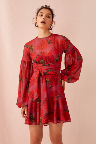 Keepsake the Label Find you mini dress Raspberry Dahlia. Features a soft lightweight georgette with a soft fit flare. Wrap tie overlay detail with balloon sleeves and cuff with gold metal buttons. Blush and Lace women's fashion boutique in Oakville.