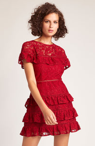 Aphrodite rouge colour mini lace dress has ruffle trim at the bust and tiered ruffle skirt. Blush and Lace, Oakville.