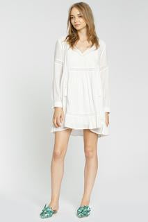 Albi dress from the brand DRA, is an ivory soft hue cropped dress. A youthful silhouette with roped ties and tassels and delicate lace details. Blush and Lace oakville, ontario. Ivory dress, textured, blush and lace, oakville, boutique, DRA