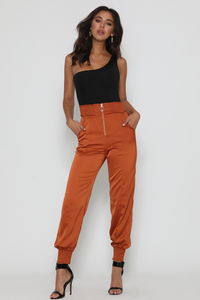 Paprika jogger rust pants by Runaway the label Australian brand. Pants, rust, zipper front, dressy, casual, clothing, trendy, unique, quality, Blush and Lace, boutique, women's, Oakville, Toronto, Mississauga, Milton, Burlington.