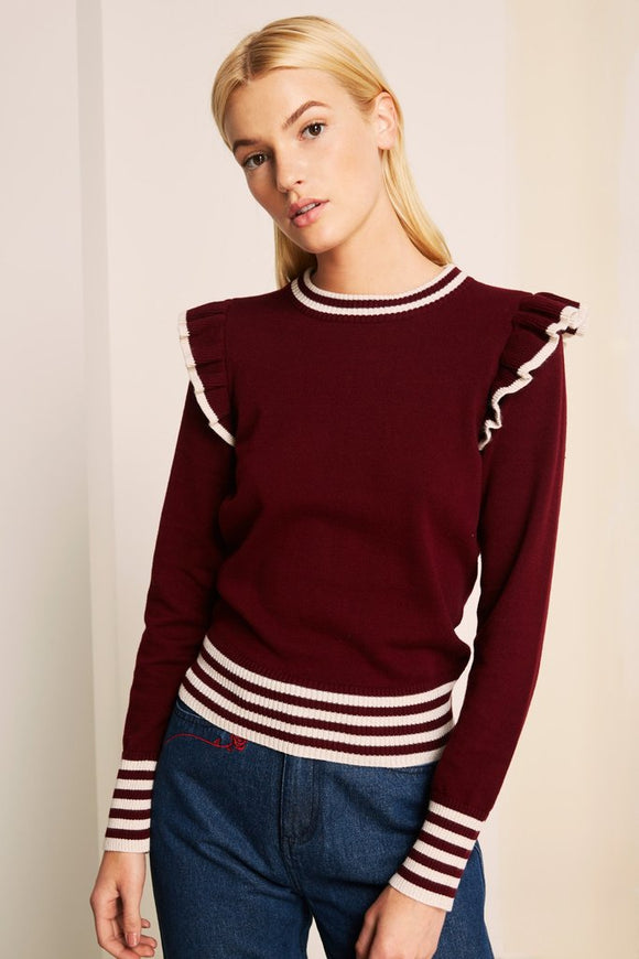 Trendy Allegiance cherry/ivory knit by the fifth label Australia. Ruffles on the shoulder, striped bottom of sleeve and bottom of waist, striped collar. Blush and lace boutique, oakville. Trendy, international, sweater, cherry red, ivory, boutique, oakville, Blush and Lace.