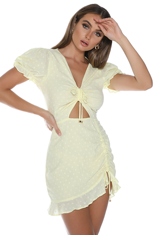 Ditsy yellow dress lemon by Runaway Australia. Yellow dress, mini length, v-neckline, short sleeves, small cutout at the waist, Blush and Lace, fashion, boutique, Oakville, upscale, trendy, women's fashion, Toronto, quality fashion.