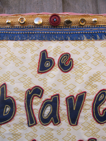 close up embroidery protest banner six moments in kingston tal fitzpatrick helen fraser