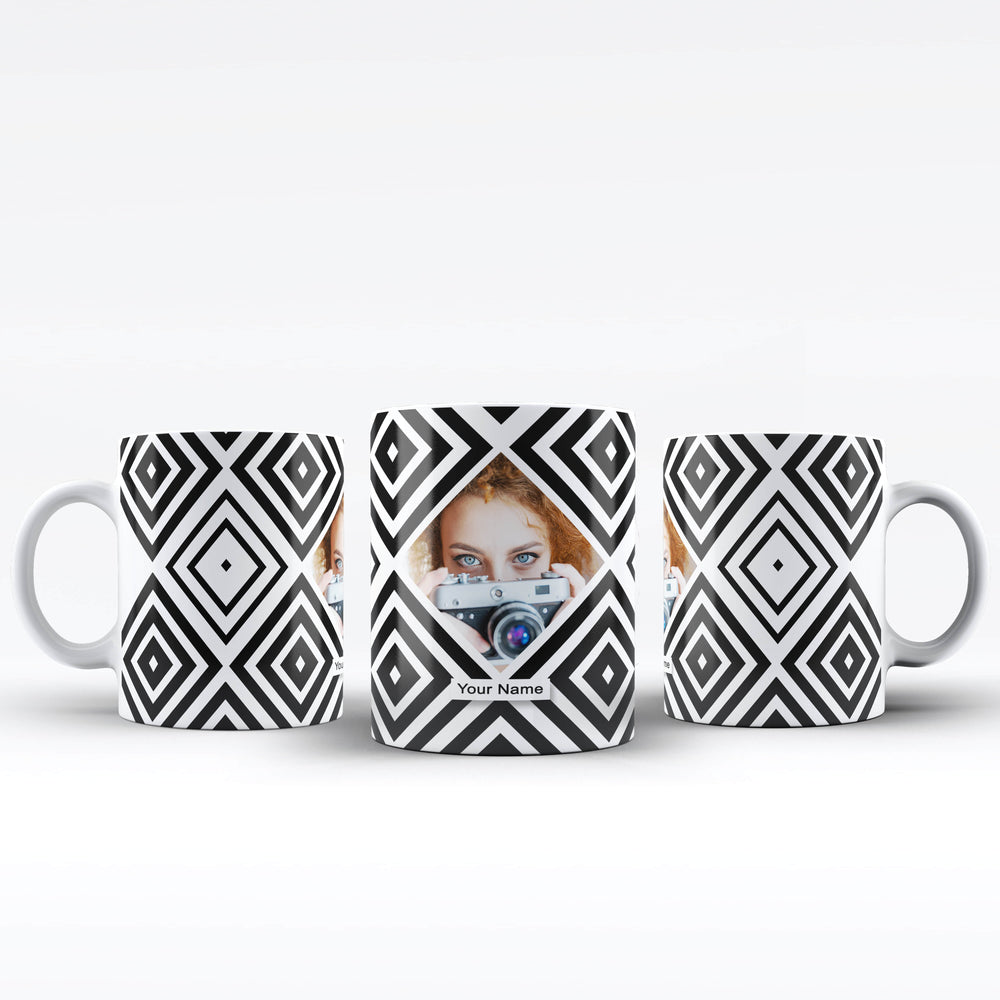 personalised white mug with black geometric pattern surrounding a diamond shaped photo in the middle with name