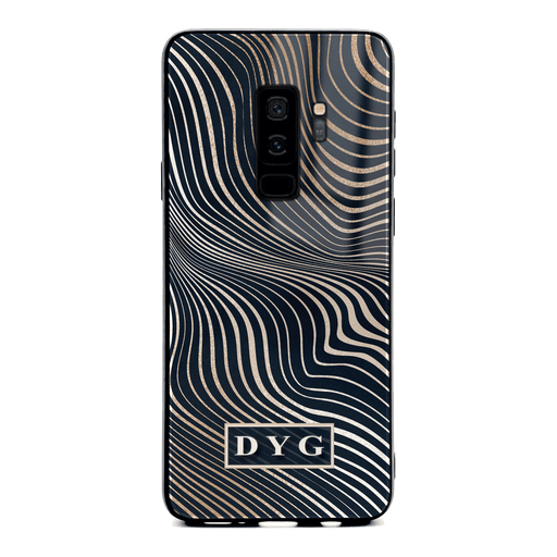 Samsung Galaxy S9+ glass phone case personalised with initials on a black glossy waves pattern