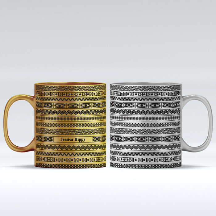 Personalised name gold mug and silver with Tribal Theme design wrapped around the mug