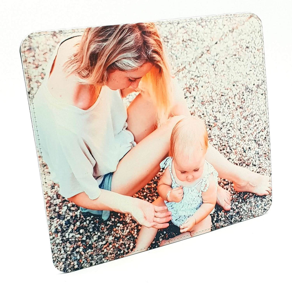 personalised 10x8 leather photo frame with a mother siting with her baby during summer on the floor