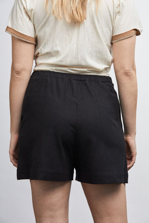size 2XL women wearing raw silk noil high waisted navy shorts with oversized raw silk top