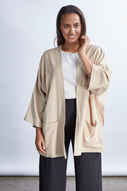 woman wearing a size medium tan raw silk noil oversized cardigan