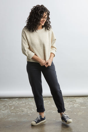 woman wearing a size medium handwoven black sweater with black pants