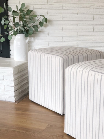 Like new upholstered striped cubed ottoman