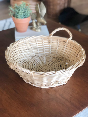 Round woven wicker basket with handles