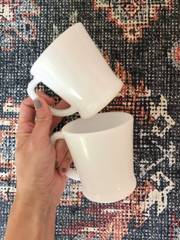 Pair of vintage white Fire King mugs