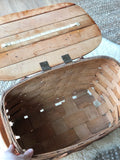 Vintage picnic basket with lid and handles