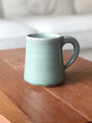 Stoneware mug in muted green