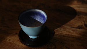 Blue glaze cup inset with silver flower