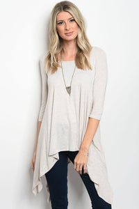 Ladies fashion 3/4 sleeve jersey relaxed fit top that features an uneven hemline